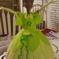 Disney Princess Tiana Cake This cake was made for my daughters 6th birthday. She loved it and I was pleased with my first doll cake!