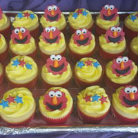 Elmo Cupcakes Ermine buttercream cupcakes with fondant Elmo and star decorations.