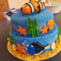 Finding Nemo Red velvet cake with cream cheese filling, buttercream frosting, covered eith fondant with fondant decorations