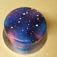 Galaxy Cake Chocolate pound cake with raspberry flavor and chocolate ganache; decorated with fondant, Wilton color mist, white white icing color and...