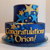 Graduation Star Cake Orion's graduation cake! A 10 inch and 6 inch 2 tier, blue and gold themed star cake! All buttercream and candy clay! No fondant, all...