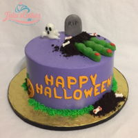 Halloween Cake Cake is iced in buttercream. MMF decorations. Those and fingers are lollipops. Dirt is Oreo cookie.