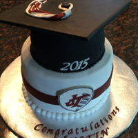 "High School Graduation 9"" round cake with a 6"" graduation cap."