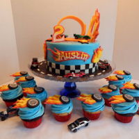 Hot Wheels Cake Austin's Hot Wheels cake and cupcakes! 8 inch cake and 2 dozen cupcakes! All candy clay and buttercream, all edible except for the...