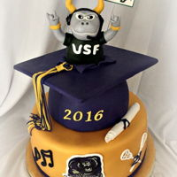 Hs/usf Grad Cake The HS grad is going to USF. Cake is covered in fondant. The top of the grad cap is a board covered with fondant. The tassel is fondant/...