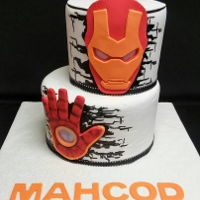 Iron Man Fondant over buttercream, fondant appliques and covered board. Red velvet and confetti cakes