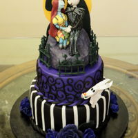 Jack Skellington And Sally Wedding Cake A two tier cake covered in fondant with fondant and gumpaste embellishments.