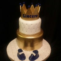 King Themed Baby Shower Cake Baby shower cake for a boy made with a dummy cake bottom tier and a strawberry filling and chocolate cake on top. Shall I mention how much...