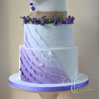 'laura' The bride's love of lavender (the flower, the colour and the flavour!) were the inspiration for this wedding cake with a sugar...