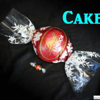 Lindt Lindor Milk Chocolate Truffle Cake Lindt Milk Chocolate Truffle cake! Cake is filled with Lindt Milk Chocolate ganache and covered in fondant and airbrushed. Logo was hand...