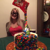 M & M Illusion Cake Double layer, deep, dark chocolate cake iced in almond American buttercream with a candy cascade!