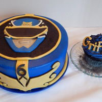 Mighty Morphin Power Rangers Griffon's Mighty Morphin' Power Rangers cake! A 10 inch round, blue power ranger cake and a jumbo cupcake just for the birthday...