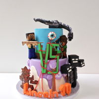 Minecraft Vs Terraria Cake loads of characters made out of modeling chocolate and fondant