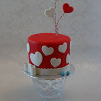 Mini Valentine Gender Reveal Cake Four inch round in fondant with baby blue Sixlets hidden inside.