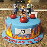 Naruto Cake Fondant Details over vanilla cake with Swiss Meringue Buttercream. Figurines not edible.