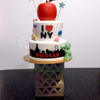 New York New York Nicolle's biggest dream is to go to New York. Hand painted skyline (no pattern used). The apple was hand carved in cake. I did not use...