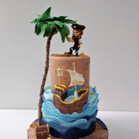 Pirate Girl Cake Pirate girl on a beachy tier while her boat gets shipwrecked. But at least she snatched the booty!