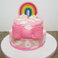 Rainbow Cake chocolate cake covered in BC, topper made of gum paste