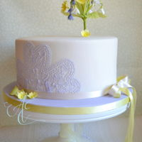Sharon Birthday cake decorated with a spring posy of sugar bluebells, snowdrops, primroses and contrasting hand piped lace.