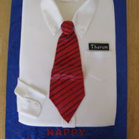Shirt And Tie 9x13 cake covered with fondant, tie and collar also fondant.