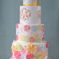 Summer A vibrant wedding cake design which screams 'Summer', bringing to mind flower-filled cottage gardens, sitting in the...