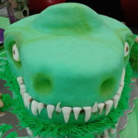 T-Rex Cake This cake was made for my nephew 5th birthday is a chocolate and vanilla flavor cake filled with chocolate ganash and shaped into a t-rex...
