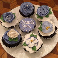 Thank You Chocolate Cupcakes Chocolate cupcakes decorated with buttercream frosting.