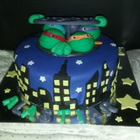 Tmnt Cake Made this one for a friends son 10in cake with all handmade ninja turtles and street cap made out of fondant