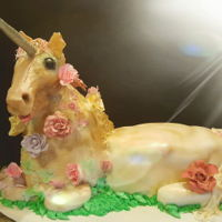 Unicorn Cake The head and shoulders are made of rkt and modeling chocolate, the body is white and chocolate cake with buttercream and covered with...