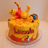 "Winnie The Pooh Cake Lincoln's first birthday cake!! An 8 inch Winnie the Pooh cake! All buttercream and candy clay with corn syrup ""honey""! All..."
