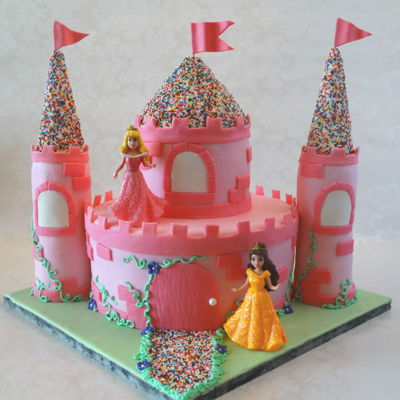 Castle Cake Eight and four inch rounds covered in fondant with RKT towers and center roof and ice cream cone tower roofs. Decorated with nonpareils and...