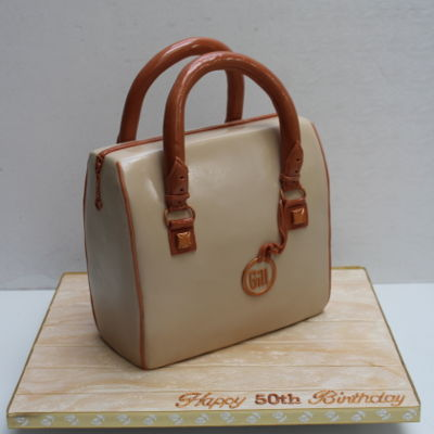It's All In The Bag This was a Madeira cake for someone who recently purchased a similar Michael Kors bag, I replaced the MK logo with her name. Handles and...
