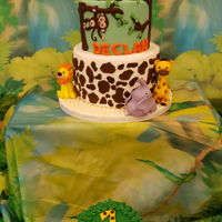 1St Birthday Safari-themed 1st birthday cake, 2 tiered (vanilla with strawberry buttercream and red velvet with cream cheese buttercream). Chocolate...