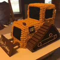 "3D Bulldozer Cake 2 8x4"" loaf pans make up the body. And a 4x4"" cut out of an 8x8 square pan make up the cab. Another square cake cut to make the..."