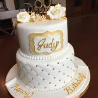 80Th Birthday Cake White vanilla cake covered with fondant with gold accents on flowers, quilt affect and name tag.