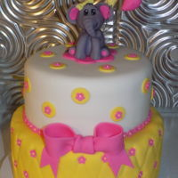 Baby Shower Elephant Vanilla Vanilla cake with fondant and gumpaste decorations.