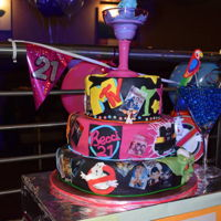 Back To The 80S My daughters 21st birthday cake for her back to the 80s party. 3 tier with 80s movie and pop culture images and gravity defying cocktail...