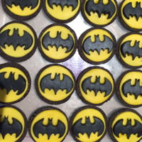 Batman Cookies. Store bought bases of arrowroot biscuits & deconstructed Oreo's with yellow fondant & black bats.