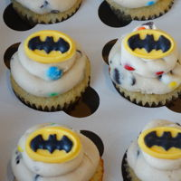 Batman Cupcakes Mini Vanilla cupcakes with Cookie Dough icing and Chocolate Batman logos.