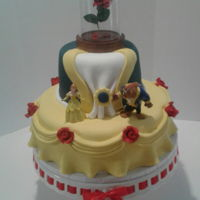 Beauty And The Beast Theme Cake Cake I made for a bridal shower. All decorations are fondant except for the Beauty and the Beast figure and of course the glass rose on the...