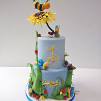 Bumblebee Cake This first birthday cake is based on a little picture book. We added some blue snails and a few ants made out of gum paste.