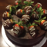Chocolate Covered Strawberry Chocolate cake, chocolate ganache, chocolate covered strawberries as decorations.