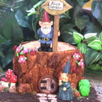 Fairy Garden Tree Stump Cake Made with fondant. Decorated with gnomes, fondant toadstools, sidewalk and more.Dirt - crushed Oreo cookiesLadybugs - red M&Ms and...