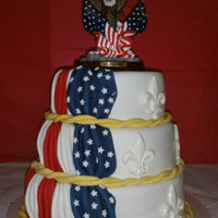 Flag Cake For Eagle Scout Award I made this cake for an eagle scout award banquet. All fondant decorations except for the top which the customer bought.