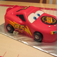 Flash Mcqueen Cake fondant covered cake with hand painted designs.