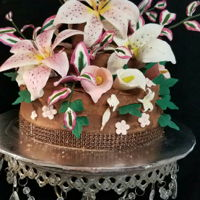 Hand Made Lilly Bouquet All hand made flowers on a chocolate Gamache cake