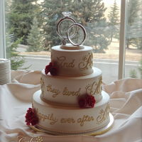 Happily Ever After Fondant covered wedding cake with fairytale quote piped in royal icing. Gumpaste roses.