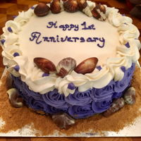 Happy Anniversary Three-layer marble cake with buttercream frosting. Decorated with milk chocolate hazelnut seashells.