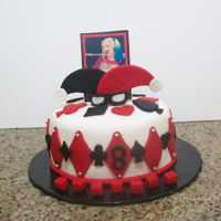 Harley Quinn red velvet cake filled with cream cheese icing covered in fondant. topper gum paste with printed image
