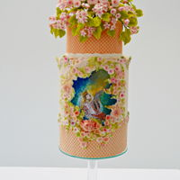 Hyperion( Spring Spanish Collaboration) double barrel cake decorates with Satin Ice fondant and SweetKolor gumpaste flowers. All flowers are freeforme made. No cutters or...